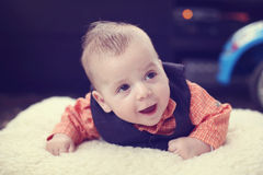 Cute baby boy on white blanket Stock Photo