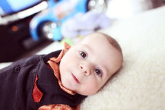 Cute baby boy on white blanket Royalty Free Stock Photo