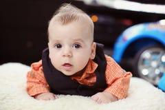 Cute baby boy on white blanket Stock Photo