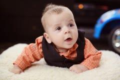 Cute baby boy on white blanket Stock Photos