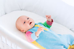 Cute baby boy in a white crib Royalty Free Stock Image