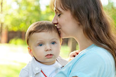 Cute baby boy less 1 year with his mom Stock Images