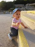 Cute Baby Boy 1 Year Wearing Striped Clothes And Standing On The. Cute Baby Boy 1 Year Wearing A Cap Backwards And Striped Clothes, Close Up Portrait, Baby stock photography