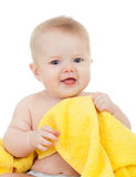 Cute baby boy in yellow towel isolated on white. Smiling baby boy in yellow towel isolated on white stock photos