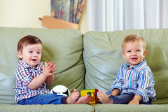 Cute baby boys playing with toys at home Stock Image
