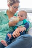 Cute baby brinking from a bottle Royalty Free Stock Photography