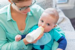Cute baby brinking from a bottle Royalty Free Stock Image
