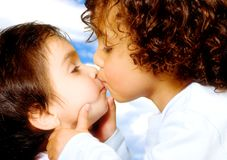 Cute baby brothers kissing Stock Photography