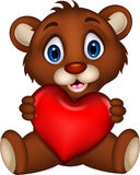 Cute baby brown bear cartoon posing with heart love Royalty Free Stock Photos