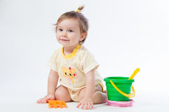 Cute baby with bucket and spade isolated on white background Royalty Free Stock Image