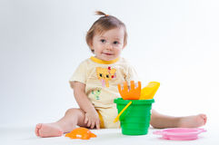 Cute baby with bucket and spade isolated on white background Stock Photography