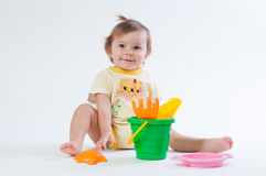 Cute baby with bucket and spade isolated on white background Royalty Free Stock Photos