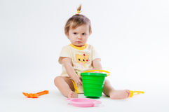 Cute baby with bucket and spade isolated on white background Stock Image