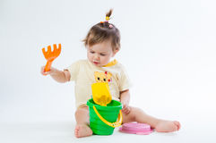 Cute baby with bucket and spade isolated on white background Royalty Free Stock Photo