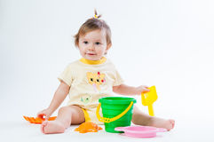 Cute baby with bucket and spade isolated on white background Stock Photo