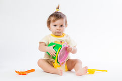 Cute baby with bucket and spade  on white background Stock Photography