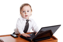 Cute baby businessman working on his laptop Stock Photo