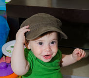 Cute Baby with a cap. Cute Funny Baby posing with a big Cap stock images