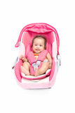 Cute baby in a car seat, isolated Stock Photo