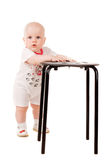 Cute baby with a chair Royalty Free Stock Image