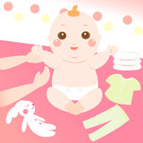 Cute baby changing clothes Royalty Free Stock Photography