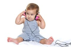 Cute baby child in headset over white Royalty Free Stock Photography