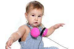 Cute baby child in headset over white Stock Photo