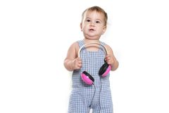 Cute baby child in headset over white Royalty Free Stock Photos