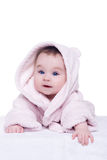 Cute baby child in pink bathrobe lying down on blanket stock photo