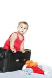 Cute baby child with a suitcase Royalty Free Stock Photos