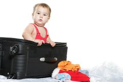 Cute baby child with a suitcase Stock Images