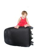 Cute baby child with a suitcase Stock Photos