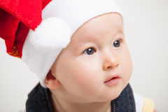 Cute baby with christmas cap Stock Image