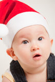 Cute baby with christmas cap Stock Images