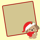 Cute baby Christmas frame with a puppy in a Santa hat. Royalty Free Stock Images