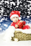 Cute baby with Christmas gift Royalty Free Stock Photography