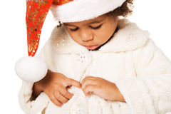 Cute baby in Christmas hat and fur Royalty Free Stock Image