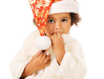 Cute baby in Christmas hat and fur Stock Images