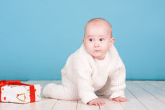 Cute baby with christmas present Royalty Free Stock Images