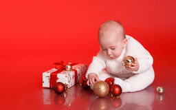 Cute baby with christmas presents and decorations Royalty Free Stock Photography