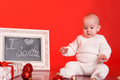 Cute baby with christmas presents and decorations Stock Photos