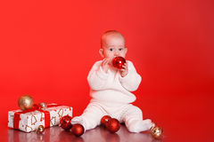 Cute baby with christmas presents and decorations Royalty Free Stock Photo