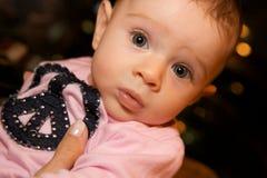 A Cute Baby With Chubby Cheeks Stock Photos