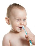 Cute baby cleaning teeth and smile. White background Royalty Free Stock Photos