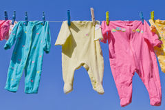 Cute Baby Clothes Hanging Stock Image