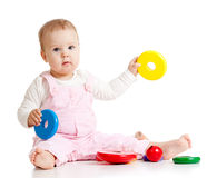 Cute baby with color educational toy Stock Photo