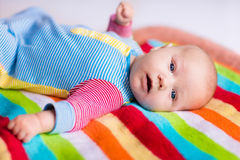 Cute baby on a colorful blanket Royalty Free Stock Images