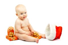 Cute baby with colorful christmas gift boxes Stock Photo