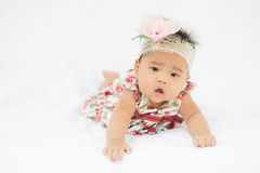 Cute baby confusing girl with rose headband Royalty Free Stock Image