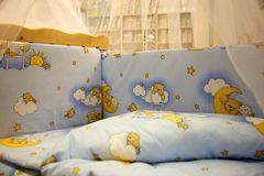 Cute baby cots with pictures stock image